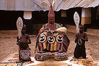 Photograph of the Deji of Akure, on throne in his courtyard.