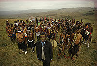 Photograph of Mangosuthu Gatsha Buthelezi surrounded by members of the Zulu tribe.