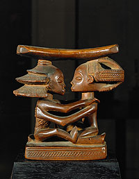 Carved wooden headrest made by the Luba people of Central Africa.