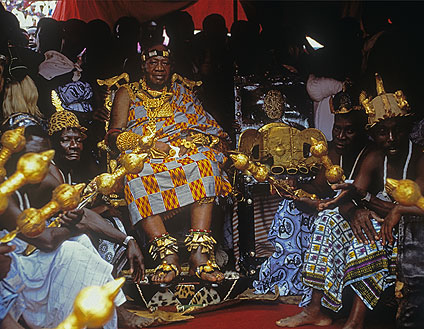 Photography of the Asantehene, ruler of the Ashanti people, sitting on his throne.