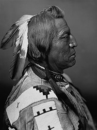 Black and white photograph of Chief Two Guns White Calf in profile.
