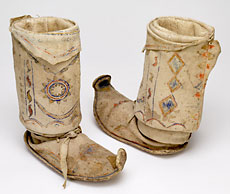 Multi-coloured rainbow (scallops), cloud (semi-circles), creator and bird images were painted with sticks on these boots.Native tanned deerskin upper, rawhide sole, sinew, pigmentsWestern Apache, circa 1880-1889P85.119