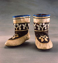 These bleached seal skin boots are appliqued with decoration at the vamp and boot shaft.