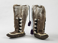 Mary Battye of Pangnirtung made these handsome caribou leg skin boots with seal skin decorative bands in 1987.