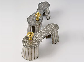 Pair of ceremonial silver padukas with ornamental gold-covered toe knobs.Silver, gold, wood, waxJaipur, 18th centuryP83.129