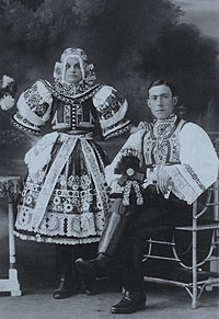 Wedding photograph of Moravian bride (standing) and groom (seated).