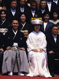 Photograph of a Japanese bride and groom in traditional wedding costume.