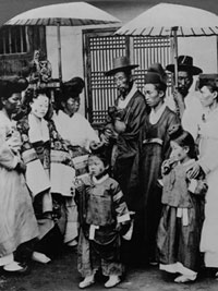 Black and white photograph depicting the Korean groom's first view of his future bride.