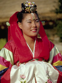 Photograph of a Korean bride in traditional costume.
