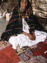 Photograph of a Berber girl dressed in a striped djellabah.