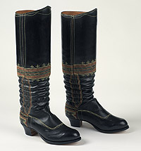 Pair of leather accordion-pleated boots with coloured stitching. Rounded toe, stacked leather Cuban heel, painted black on outside.