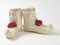 Pair of white reindeer leg boots with felted wool liners.
