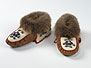 Made by Louisa Denetre, Fort Providence, Northwest Territories Moosehide, wool cloth, moose hair, beaver fur